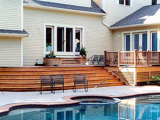 DECKS - LAYERED SOLUTIONS FOR A BACKYARD POOL GARDEN