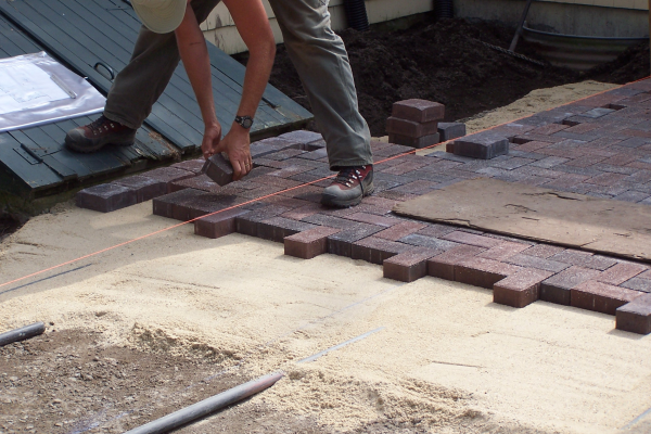 laying-pavers-patio